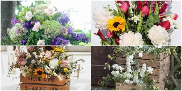 Arranjos de flores em caixotes de madeira