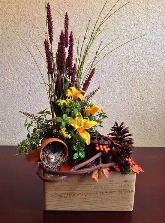 Lindos arranjos de flores em caixotes