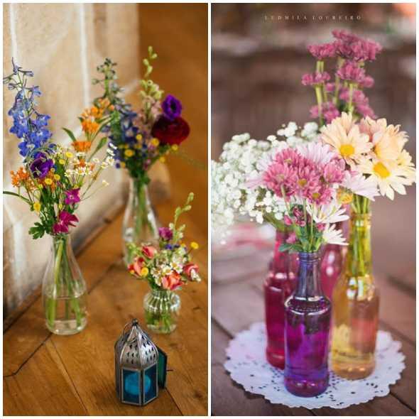 Decoração com flores em garrafas de vidro